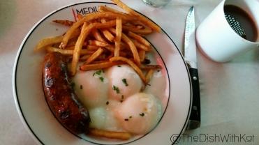 Medium Rare's Egg, Frites & Sausage features a local artisan sausage made by Cliff Logan.