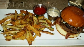 The B' Burger piles on Maytag blue cheese, bacon, sautéed mushrooms, caramelized onion, and is served with fries.