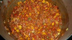 Add the taco seasoning and canned fire-roasted tomatoes