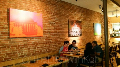 Zest Bistro boasts an exposed brick wall and art of various D.C. landmarks