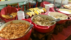 The Butchers Table also includes Shredded Chicken and Carnitas for Tacos, Farm-a-Roni (rice dish), Cheesy Grits, and Breakfast Jambalaya.