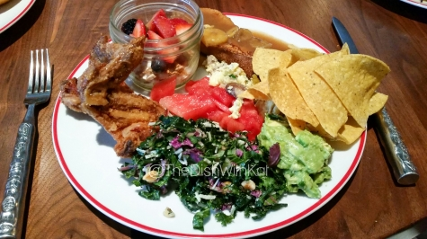 Plate number one with (clockwise from top) Sweet Bread French Toast, Chips & Guacamole, Kale Salad, Fried Chicken, Yogurt Parfait, and Watermelon Salad.