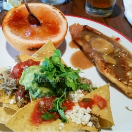Plate number two with (clockwise) Brûléed Pink Grapefruit, Sweet Bread French Toast, and Carnitas Nachos.