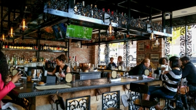 The beautiful wrought iron work can be found at the bar and frames the floor-to-ceiling windows.