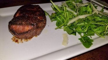 Filet Mignon served with an Arugula Salad