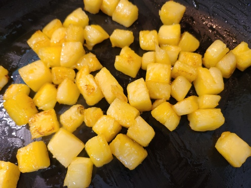 Cook the diced Pineapple in Butter until caramelized.